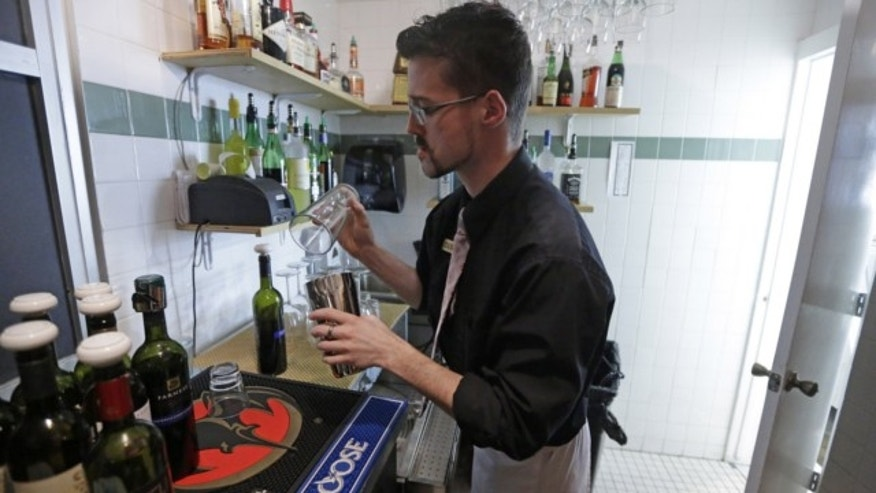 FILE: Feb. 26, 2013: Manager Dustin Humes fixes a drink in a small room which is out of the view of patrons at Vivace Restaurant, in Salt Lake City.