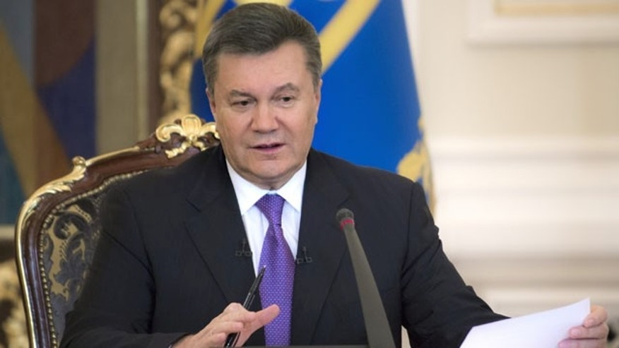 December 19, 2013: Ukrainian President Viktor Yanukovych speaks during a press conference in Kiev. (AP Photo/Mykhailo Markiv, Pool)