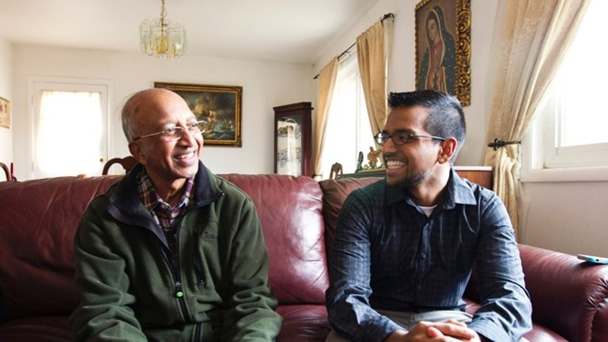 FILE: Jan. 17,  2014: Yves Gomes, a college student whose parents were deported, right, talks to a great uncle in Silver Spring, Md.