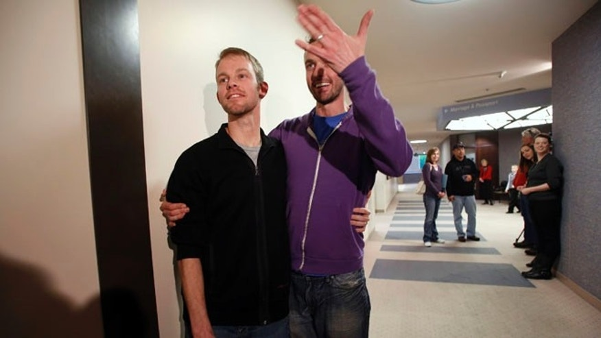 Dec. 20, 2013: The first gay couple to be married in Utah, Seth Anderson (L) and Michael Ferguson, are seen after getting married at the Salt Lake County Clerks office in Salt Lake City, Utah.