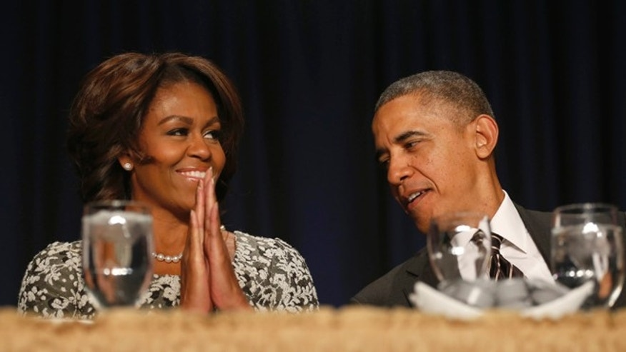 Feb. 6, 2014: President Obama and first lady Michelle Obama talk during the National Prayer Breakfast in Washington.