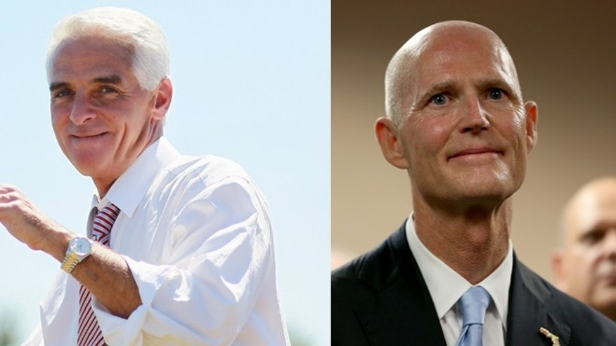 Democratic candidate for Florida Governor Charlie Crist and Republican Florida Governor Rick Scott.