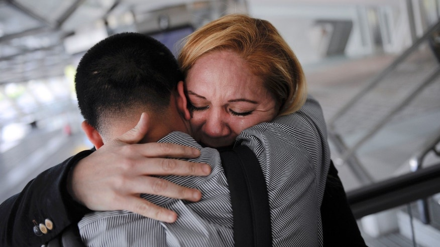 In this Wednesday, Dec. 25, 2013 photo, Melba Soza embraces her son Jose Antonio as he arrives at the airport in Bilbao, Spain from the United States for a five-day visit with his mother. For the past three years, Jose has been on a mission: To bring his mother back to the U.S. His work has taken him to Congress, gotten him meetings with the likes of Donald Trump and Mark Zuckerberg, landed him on television. Along the way, he has grown into a steady force in the national immigration debate, a young but powerful voice for his family and the many others hoping to one day reunite. (AP Photo/Alvaro Barrientos) PART OF A 14-PICTURE PACKAGE