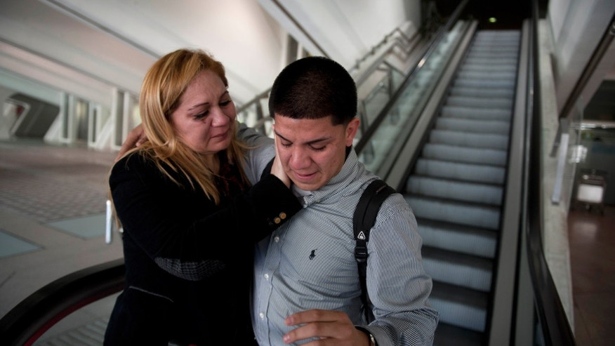 "In this Wednesday, Dec. 25, 2013 photo, Melba Soza comforts her son Jose Antonio, as he arrives at the Bilbao, Spain, airport from the United States. ""I was afraid you would have lost the love for your mother,"" she told him. ""I was afraid youâd look at me like a stranger,"" he said. (AP Photo/Alvaro Barrientos)"
