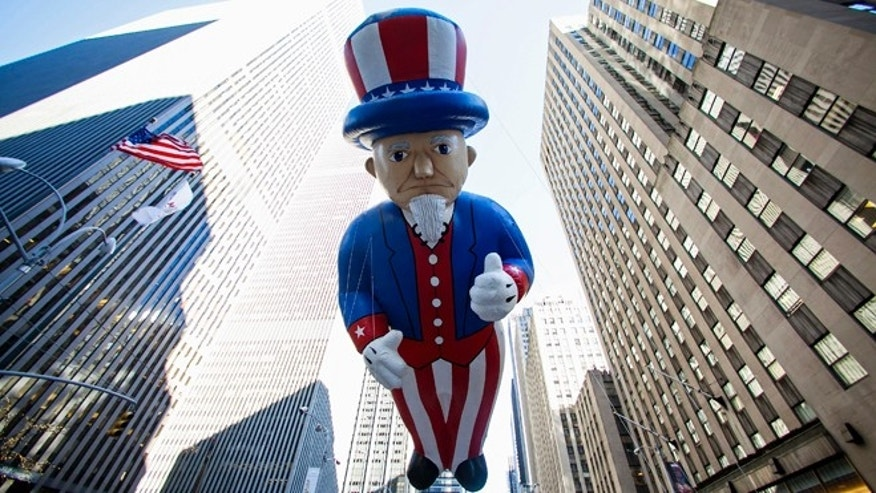 Nov. 28, 2013: An Uncle Sam balloon floats down Sixth Avenue during the 87th Macy's Thanksgiving Day Parade.