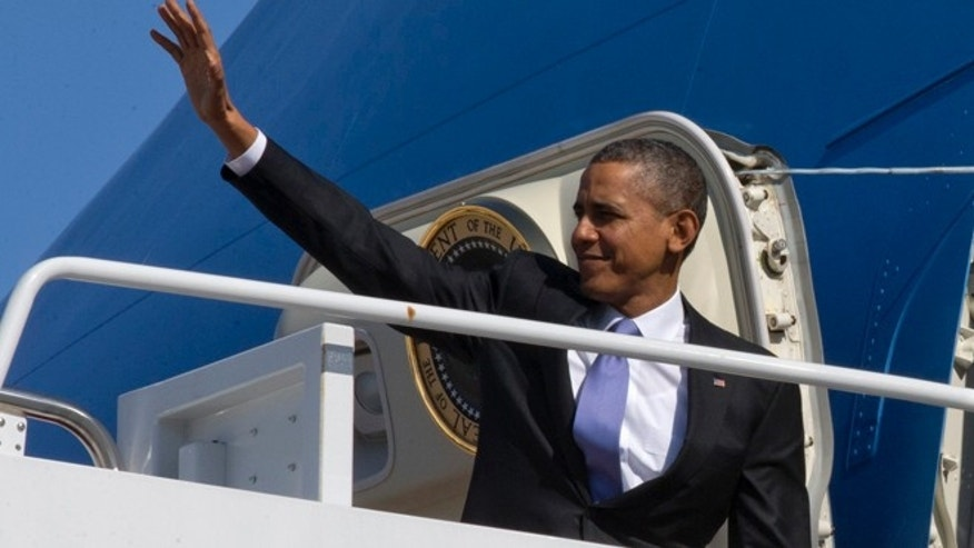 Feb. 14, 2014: President Barack Obama waves he boards Air Force One at Andrews Air Force Base, Md., en route to travel to Fresno, Calif., to discuss the ongoing drought.