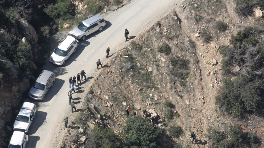 This aerial photo shows the scene of a shooting by a U.S. Border Patrol agent near San Diego on Tuesday, Feb. 18, 2014.