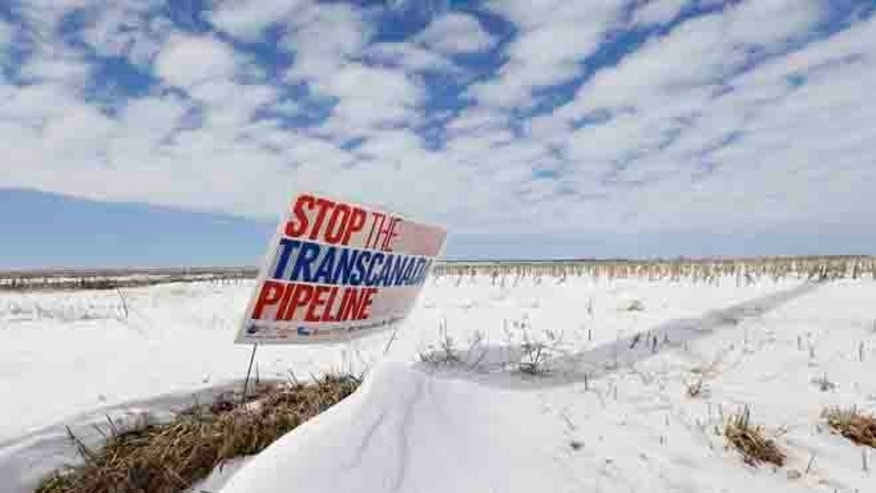 "March 11, 2013 In thisphoto, a sign reading ""Stop the Transcanada Pipeline"" stands in a field near Bradshaw, Neb., along the Keystone XL pipeline route through the state."