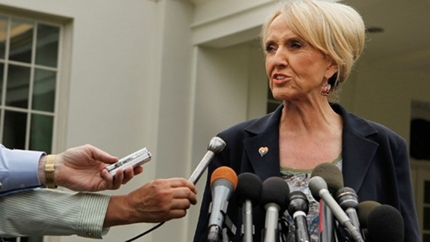 Arizona Governor Jan Brewer (R) takes questions from members of the news media outside the West Wing at the White House after meeting with U.S. President Barack Obama June 3, 2010 in Washington, DC.  (Photo by Chip Somodevilla/Getty Images)