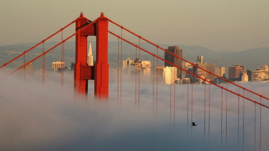 FILE: April 18, 2009: The skyline of San Francisco and the Golden Gate Bridge appear above the evening fog in Sausalito, Calif.