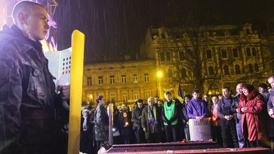 FILE: February 21, 2014: A funeral for an anti-government protester who was killed during clashes with riot police, in Lviv, Ukraine.