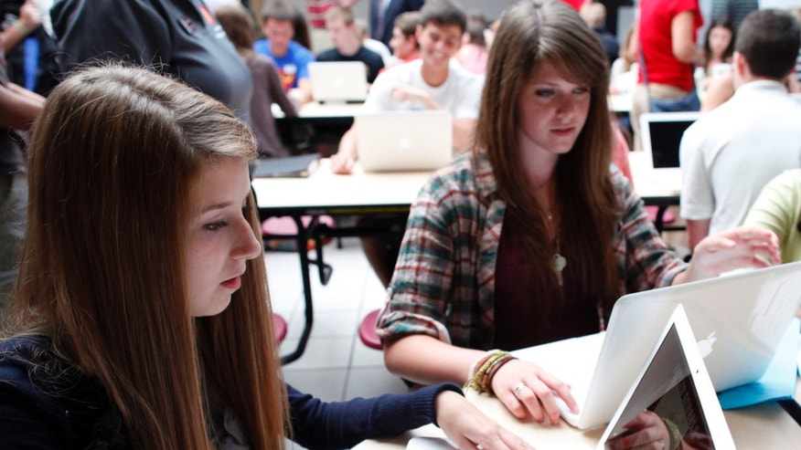FILE: Aug. 17, 2011: Students with laptops at Joplin High School in Joplin, Missouri.