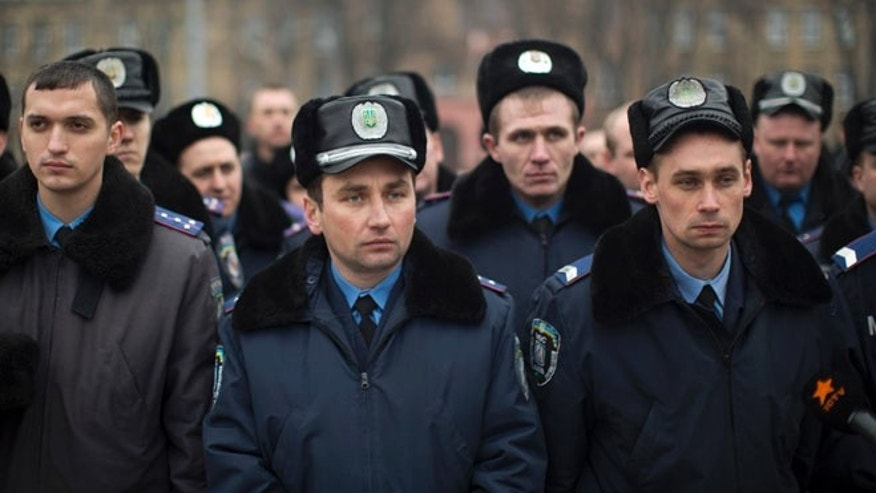 March 1, 2014: Ukrainian police officers at a rally in Kiev, Ukraine.