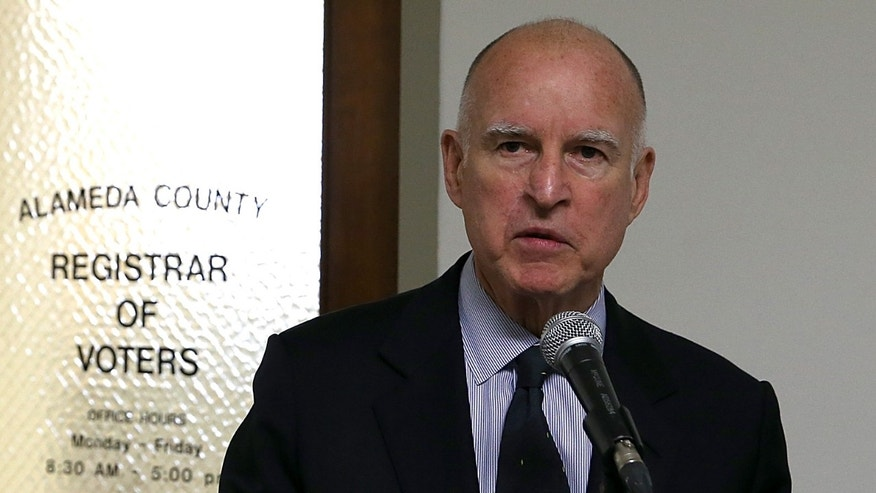 OAKLAND, CA - FEBRUARY 28:  Anne Gust Brown (L) looks on as her husband, California Gov. Jerry Brown, speaks to reporters after filing paperwork for re-election at the Alameda County Registrar of Voters> on February 28, 2014 in Oakland, California.  Gov. Brown submitted paperwork to officially launch his 2014 re-election campaign.  (Photo by Justin Sullivan/Getty Images)