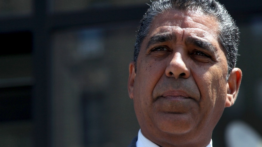 New York State Se. Adriano Espaillat speaks during a news conference in New York, Monday, July 9, 2012. Espaillat conceded the congressional race to his opponent, incumbent Charles Rangel. (AP Photo/Seth Wenig)