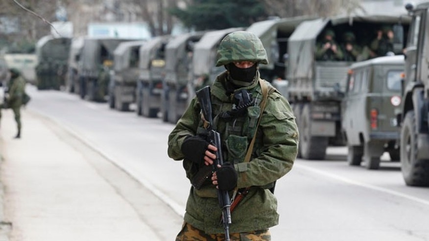 FILE:  March 1, 2014: Armed servicemen wait in Russian army vehicles  in the Crimean town of Balaclava,Ukraine.
