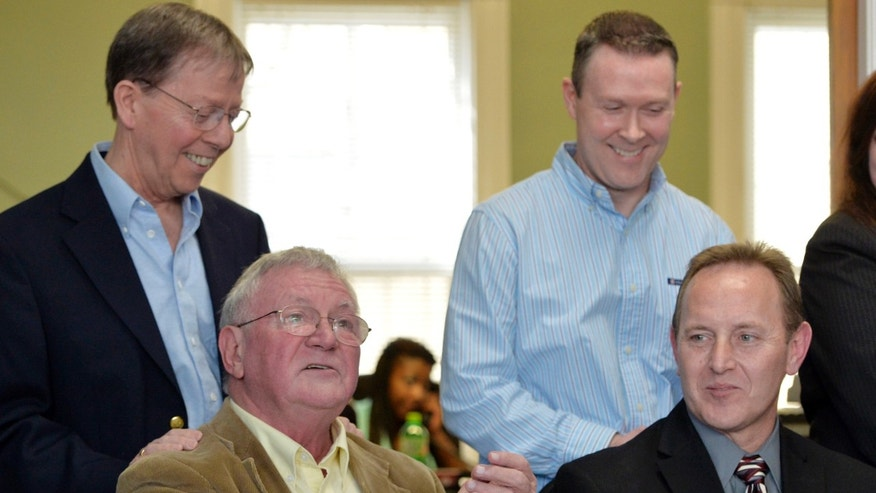 Feb. 12, 2014: Luke Barlowe, front left, his partner, Jim Meade, rear left, Randy Johnson, front right, and hia partner Paul Campion answer questions from reporters following the announcement from U.S. District Judge John G. Heyburn striking down Kentucky's same-sex marriage ban.