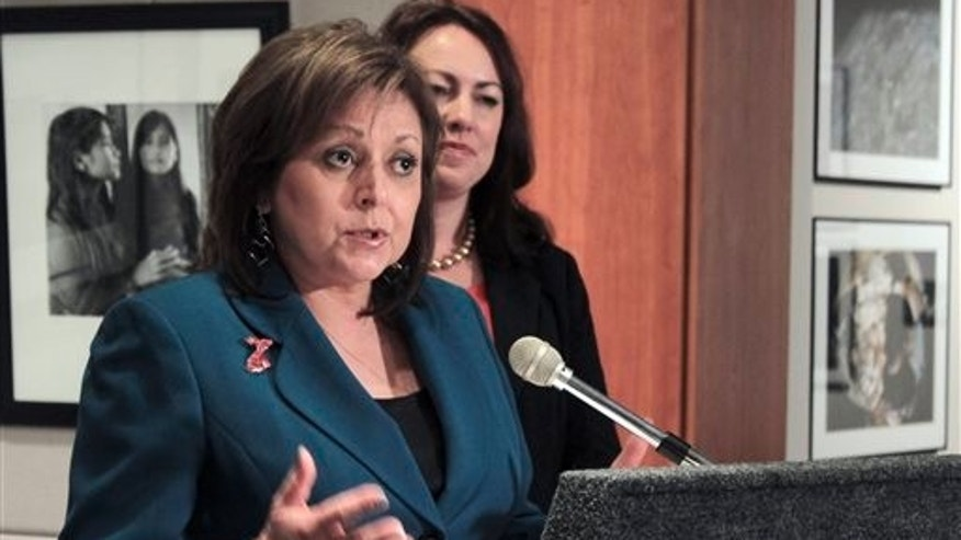 New Mexico Gov. Susana Martinez talks about her support of legislation to temporarily shore up a lottery-funded college scholarship program during a news conference Thursday, Feb. 20, 2014, following the 30-day legislative session in Santa Fe, N.M.(AP Photo/Susan Montoya Bryan)