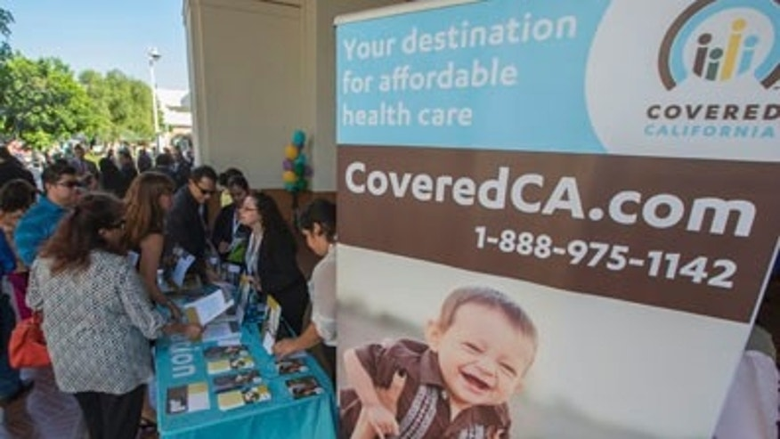 People sign up for health insurance information at a Covered California event which marks the opening of the state's Affordable Healthcare Act, commonly known as Obamacare, health insurance marketplace in Los Angeles, California, October 1, 2013. Technical glitches and heavy internet traffic slowed Tuesday's launch of new online insurance exchanges at the heart of President Barack Obama's healthcare reform, showcasing the challenge of covering millions of uninsured Americans. REUTERS/Lucy Nicholson (UNITED STATES - Tags: POLITICS HEALTH) - RTR3FI11