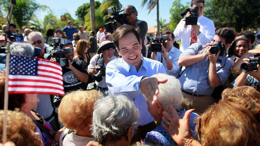 MIAMI - APRIL 27:  Marco Rubio is greeted by supporters after signing election documents officially qualifying him as a Republican candidate for the U.S. Senate on April 27, 2010 in Miami, Florida. Rubio would become the Republican candidate to beat if his current challenger, Florida Governor Charlie Crist, switches parties to become an Independent candidate.  (Photo by Joe Raedle/Getty Images) *** Local Caption *** Marco Rubio