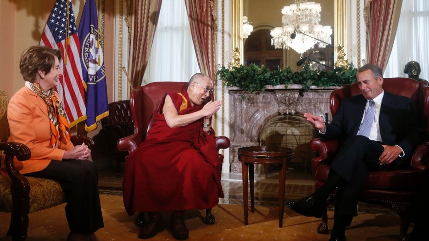 Dalai Lama meets with House Speaker John Boehner  and House Minority Leader Nancy Pelosi on Capitol Hill in Washington, Thursday, March 6, 2014. (AP Photo/Charles Dharapak)
