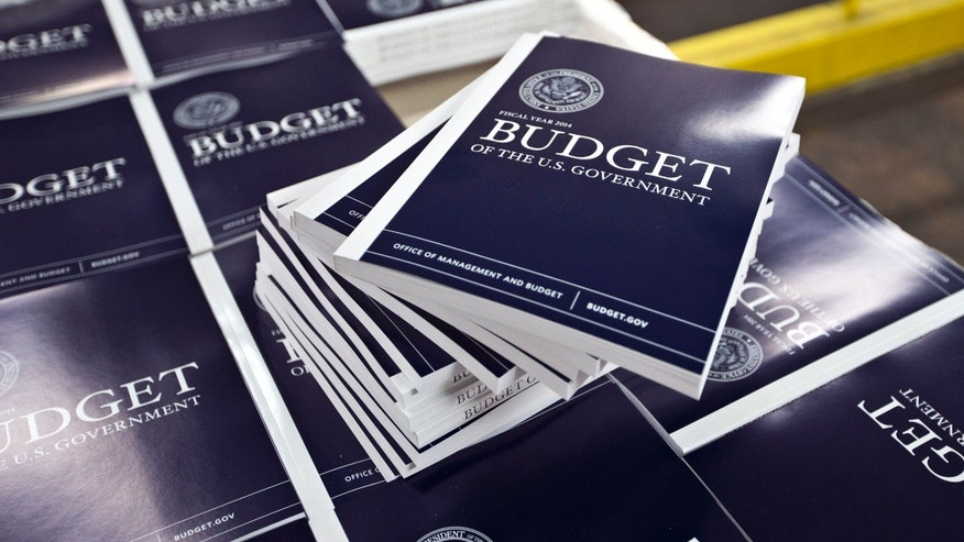 April 8, 2013: Copies of President Obama's budget plan for fiscal year 2014 are prepared for delivery at the U.S. Government Printing Office in Washington.
