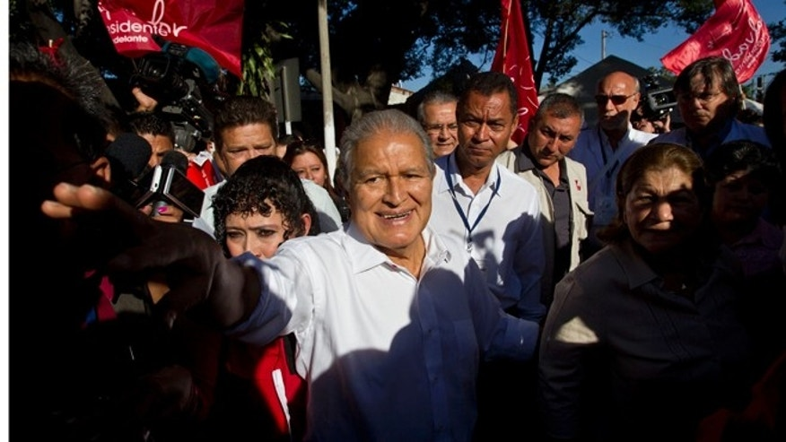 FILE - In this Feb. 2, 2014 file photo, Vice President Salvador Sánchez Cerén, presidential candidate for the ruling Farabundo Marti National Liberation Front (FMLN), greets supporters after voting at a polling station in San Salvador, El Salvador. Sanchez, a former guerrilla commander, is the favorite to win the second round presidential election Sunday, March 9, 2014. (AP Photo/Esteban Felix, File)