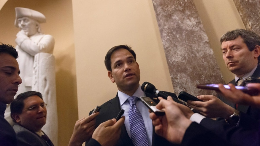 Sen. Marco Rubio, D-Fla., talks to reporters on Capitol Hill in Washington, Wednesday, March 5, 2014, after President Barack Obama's choice to head the Justice Department's civil rights division failed a Senate test vote and put the confirmation of Debo Adegbile in jeopardy.  (AP Photo/J. Scott Applewhite)