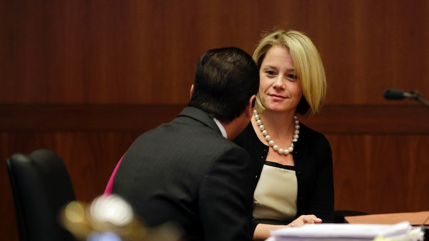 March 11, 2014: New Jersey Gov. Chris Christie's former Deputy Chief of Staff Bridget Anne Kelly waits in court for a hearing.