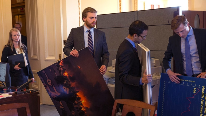 March 10, 2014: Senate staff members arrive prior to a meeting of the Senate Climate Action Task Force prior to taking to the Senate Floor all night to urge action on climate change on Capitol Hill.