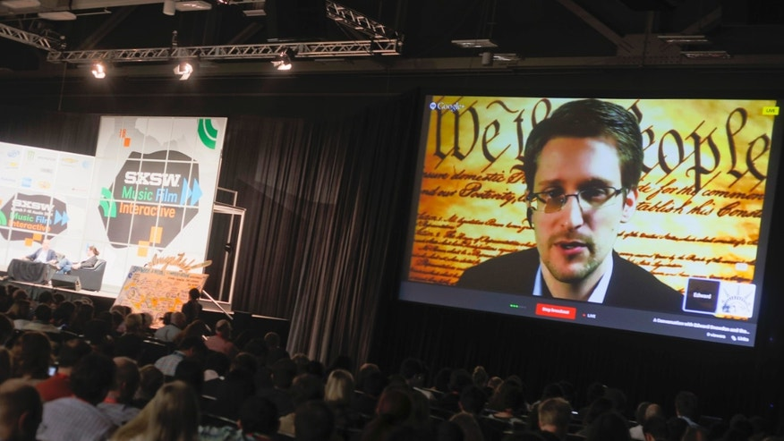 March 10, 2014: Edward Snowden talks during a simulcast conversation during the SXSW Interactive Festival on Monday,  in Austin, Texas.