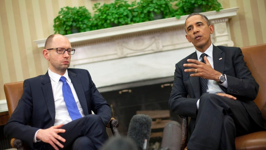 March 12, 2014: President Barack Obama, right, with Ukraine Prime Minister Arseniy Yatsenyuk, left, talk in the Oval Office of the White House in Washington.