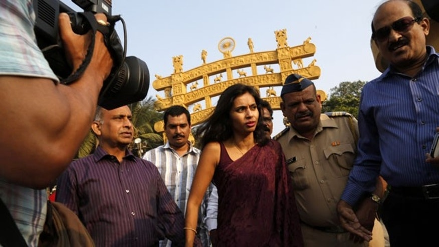 FILE - In this Tuesday, Jan. 14, 2013 file photo, diplomat Devyani Khobragade, center, arrives at Chaitya Bhoomi, a memorial to Indian freedom fighter B.R. Ambedkar, with her father Uttam Khobragade in Mumbai, India. (AP Photo/Rajanish Kakade)