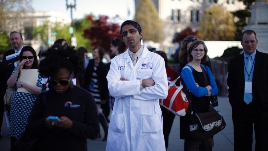 Mar. 26, 2012: Dr. Vivek Murthy stands among other bystanders during the first day of legal arguments over the Affordable Care Act outside the Supreme Court.