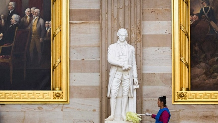 FILE: October 15, 2013: A statue of Alexander Hamilton being cleaned in the Rotunda on Capitol Hill in Washington, D.C.