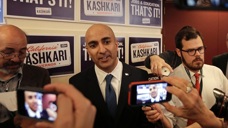 Gubernatorial candidate Neel Kashkari, second from left, speaks with reporters at the California Republican Party 2014 Spring Convention Saturday, March 14, 2014, in Burlingame, Calif. (AP Photo/Ben Margot)