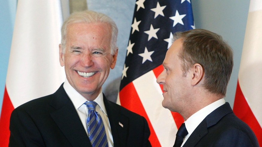 March 18, 2014: U.S. Vice President Joe Biden, left, and Polands Prime Minister Donald Tusk, right, pose for media before heading for talks on Eastern Europes security, in Warsaw, Poland.