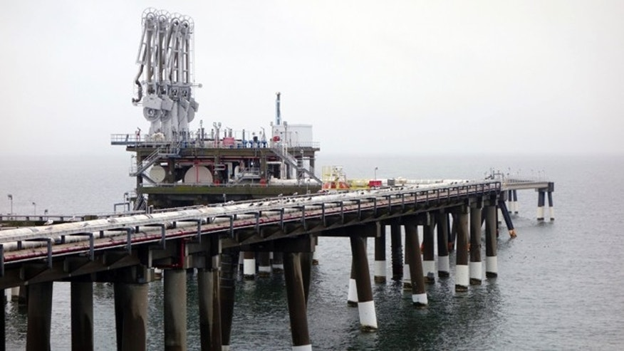 FILE: Feb. 5, 2014: The pier at Dominion's Cove Point liquefied natural gas plant on Maryland's Chesapeake Bay.