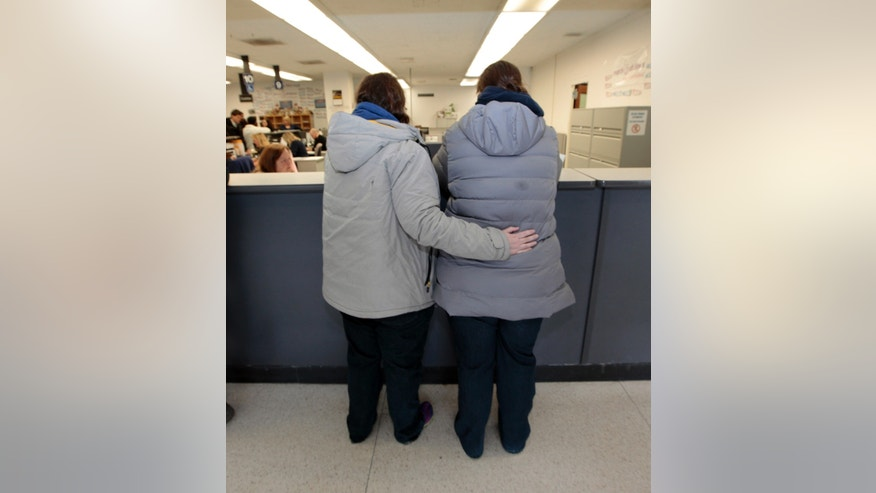 March 22, 2014: A same sex couple wait for a marriage license at the Oakland County Clerks office in Pontiac, Mich.