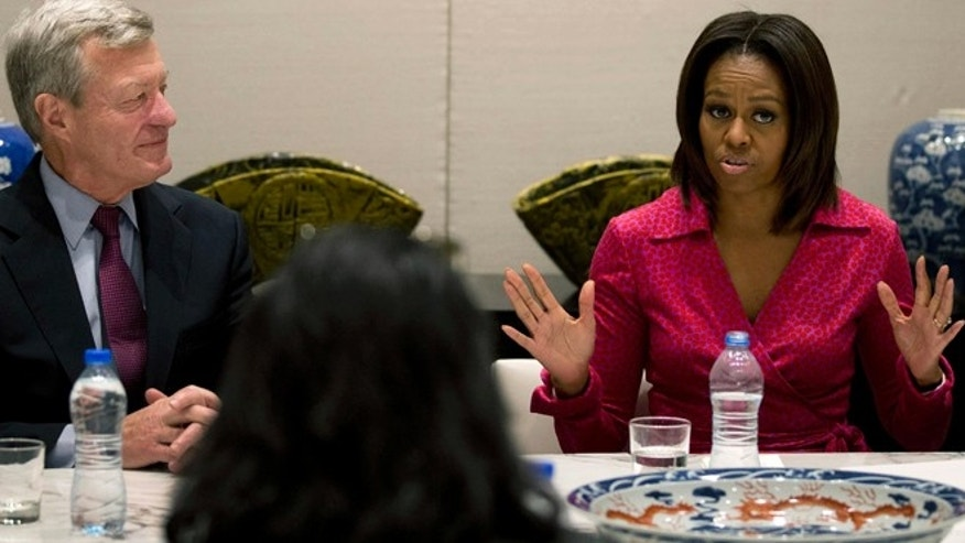 March 23, 2014: U.S. first lady Michelle Obama, right, speaks next to U.S. Ambassador to China Max Baucus as they attend a round table discussion on education at the U.S. Embassy in Beijing, China.