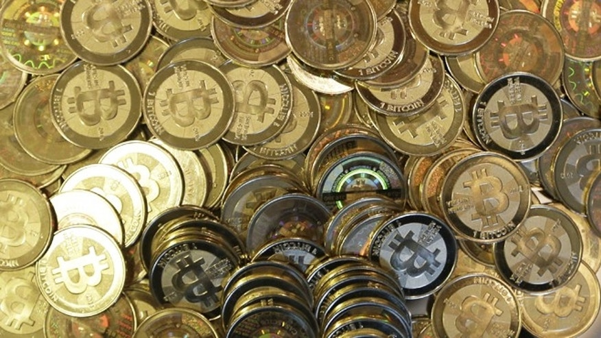 April 3, 2013: Bitcoin tokens at 35-year-old software engineer Mike Caldwell's shop in Sandy, Utah. Caldwell mints physical versions of bitcoins, cranking out homemade tokens with codes protected by tamper-proof holographic seals.