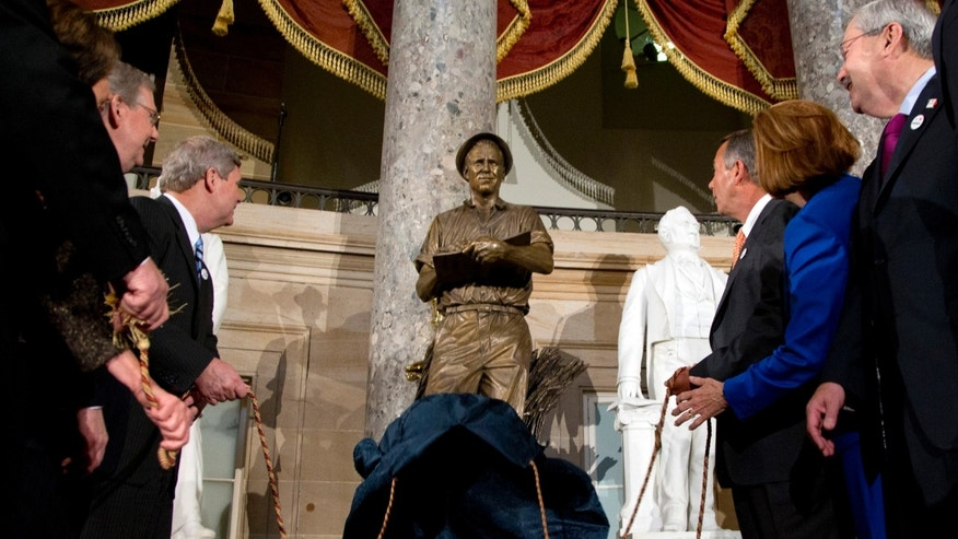 March 25, 2014: Lawmakers look to a statue of the late Dr. Norman E. Borlaug during its unveiling in National Statuary Hall on Capitol Hill in Washington.