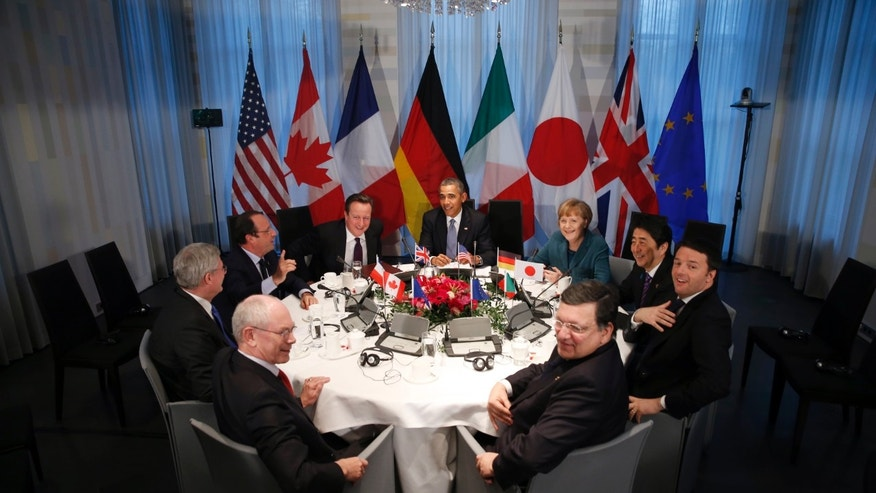 President of European Union Council Herman Van Rompuy, Canada's Prime Minister Stephen Harper, France's President Francois Hollande, Britain's Prime Minister David Cameron, U.S. President Barack Obama, Germany's Chancellor Angela Merkel, Japan's Prime Minister Shinzo Abe, China's President Xi Jinping and EU Commission President Jose Manuel Barosso (L-R, clockwise) meet during the Nuclear Security Summit in The Hague on March 24, 2014.