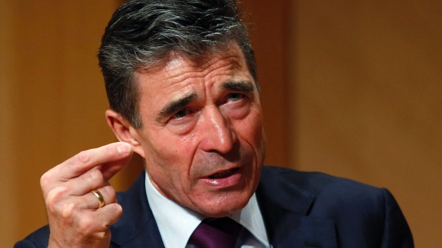 Mar. 19, 2014: NATO Secretary General Anders Fogh Rasmussen gestures while speaking after receiving the Hillary Rodham Clinton Award for Advancing Women in Peace and Security at Georgetown University in Washington.