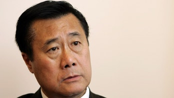 In this file photo California State Senator Leland Yee talks in his office about the state's budget impasse in San Francisco, California.