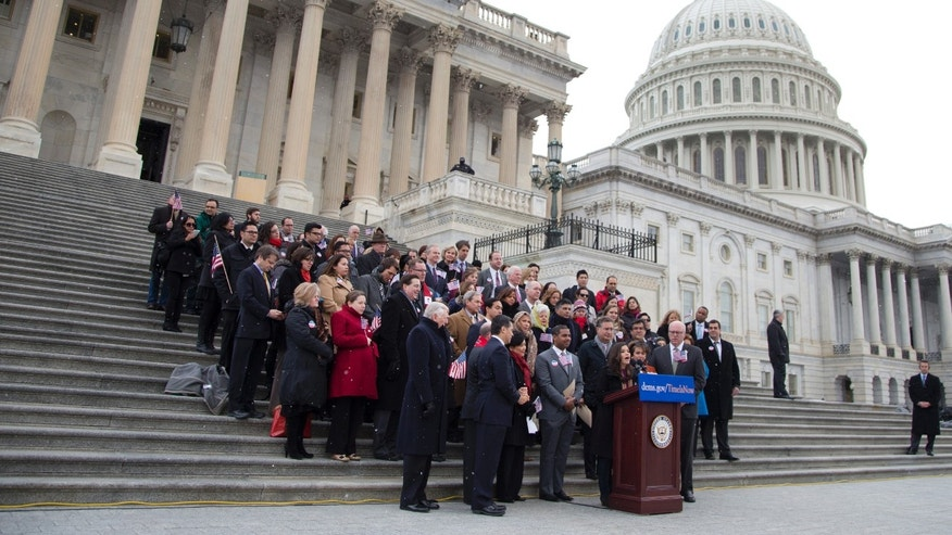 House Democrats and immigration leaders on the steps of the Capitol in Washington, March 26, 2014