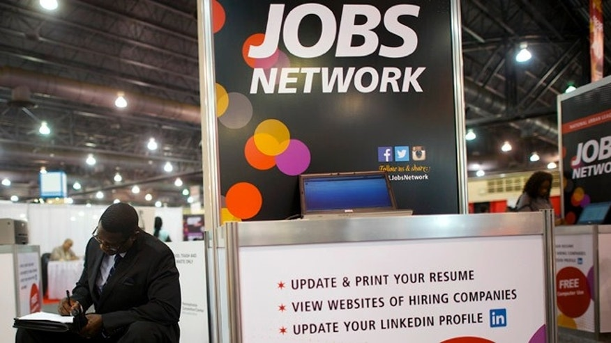 July 25, 2013: A job-seeker completes an application at a career fair held by civil rights organization National Urban League as part of its annual conference, in Philadelphia.