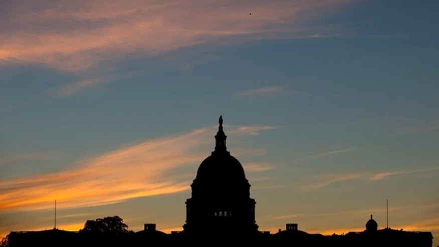 FILE - In this Sept. 15, 2013, file photo, the U.S. Capitol dome is silhouetted by the sunrise. (AP Photo/Carolyn Kaster, File)