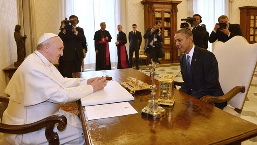 March 27, 2014: Pope Francis meets President Barack Obama at the Vatican. (AP Photo/Gabriel Bouys, Pool)
