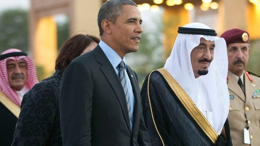 Mar. 28, 2014: Saudi Arabia's Crown Prince Salman bin Abdulaziz Al Saud, escort President Obama to his meeting with Saudi King Abdullah at Rawdat Khuraim, Saudi Arabia.